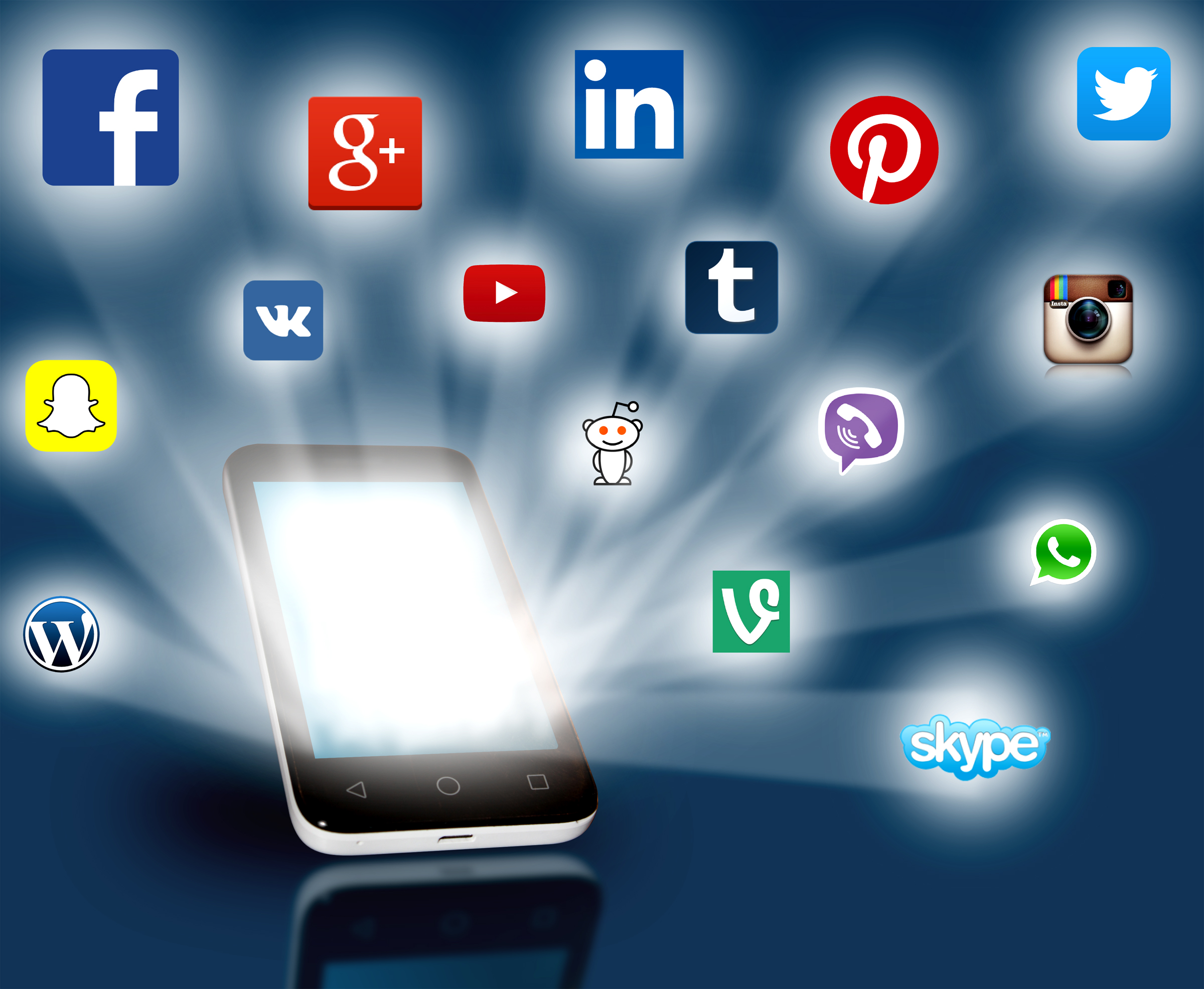 Social media networks projecting out from smartphone. Editorial use only
